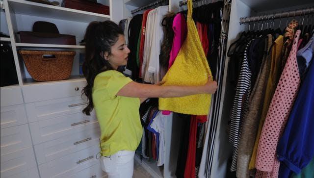 The yellow dress Daniella Monet wore to the Nickelodeon Kids' Choice Awards now hangs in her new custom closet.