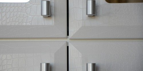 Close up of the Faux White Alligator Faces detail designed for Jill Zarin's Wall Unit.