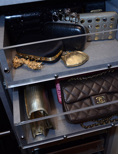 Custom drawers with Lucite fronts designed to store Jill's smaller purses and clutches.