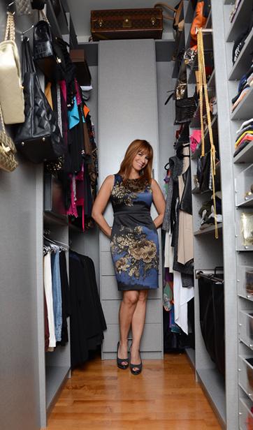 Jill staning inside her very tall walk in closet.