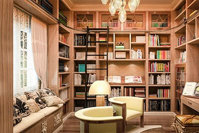 Bedroom converted into a home library with floor to ceiling shelving.