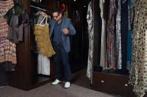 naeem khan looks at hanging clothing stored in custom closet