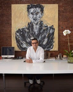 naeem khan in his office behind desk