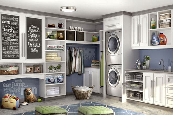 Trendy pet nook with dog in laundry room, standing sink area, stackable baskets for sorting laundry, upper cabinets and base cabinets.
