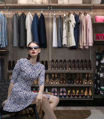 large closet system with organized clothing includes shoes, handbags, dresses and seperates.