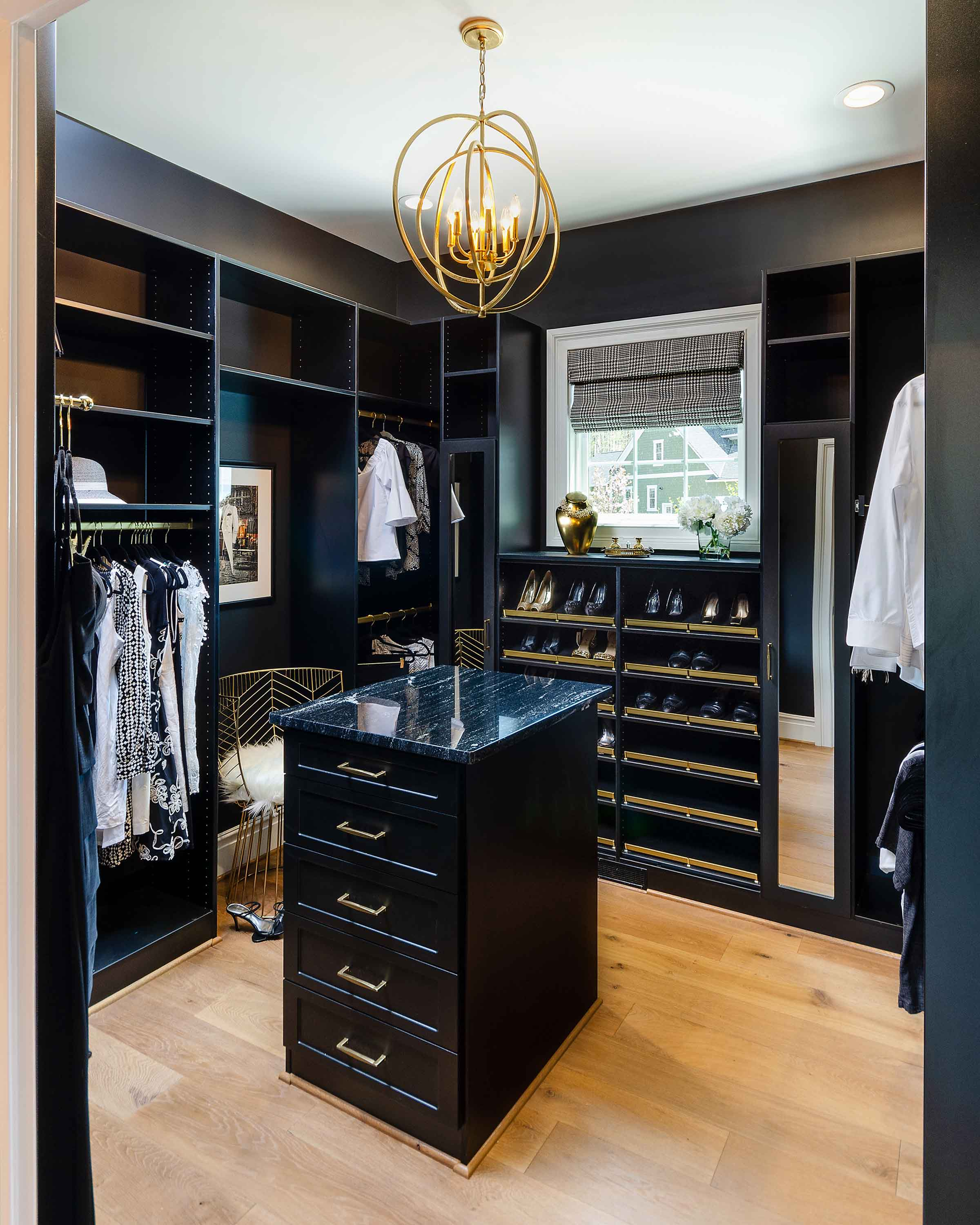 Black Closet System For Walk In Closet With An Island.