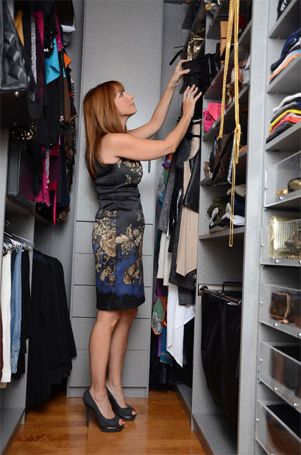 Seeing what's in her tall closet is not a problem now that she has a new custom closet organizer system to make everything easily visible.