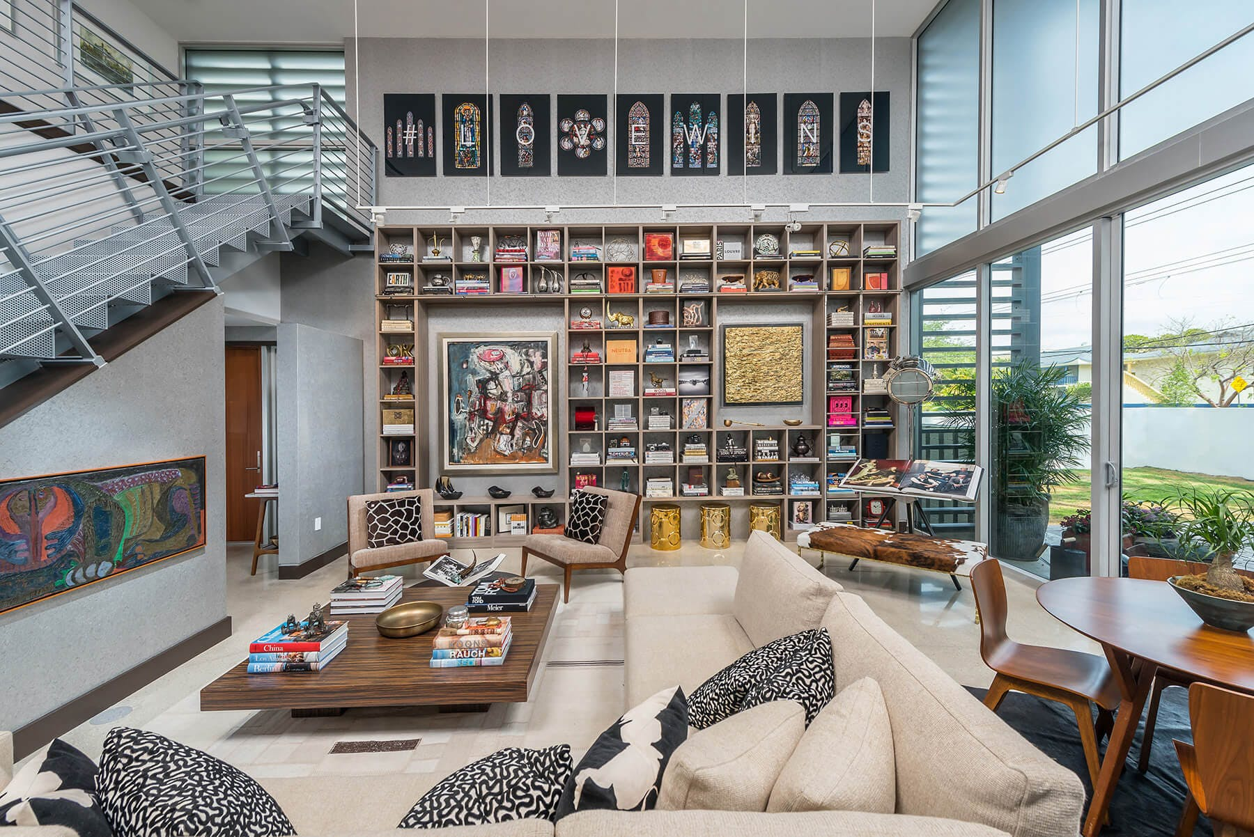 Wall unit features art collection in this miami home.