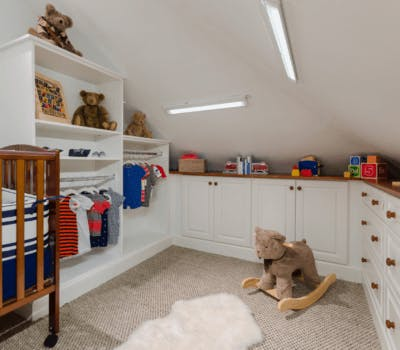 Before & After: From Attic To Custom Nursery Design Just In Time For Baby