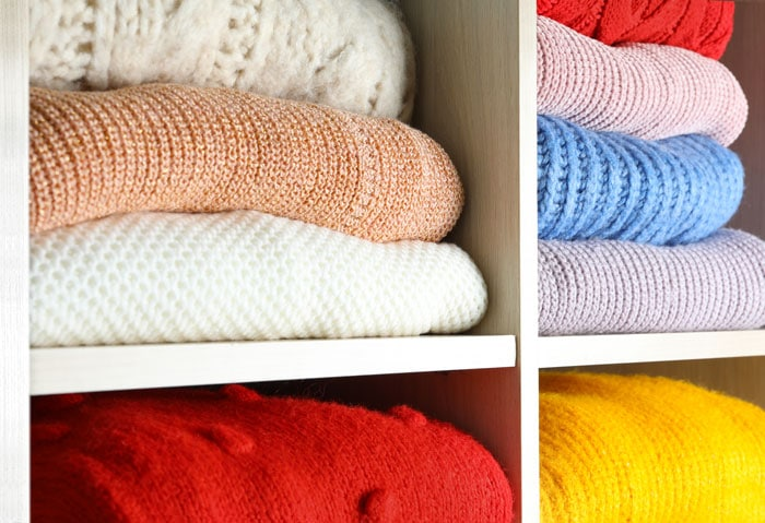 cubbies filled with folded sweaters