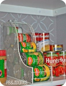 wire can rack with cans in it