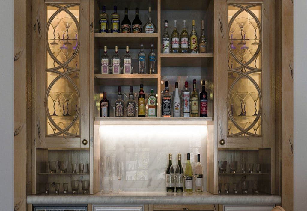 custom home bar with decorative glass doors