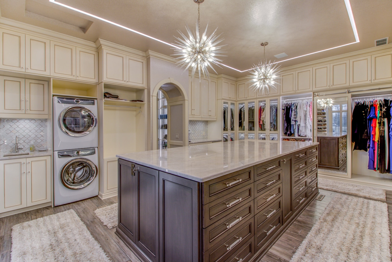 Beautiful Center Island And Elegant Lighting For Custom Walk In Closet