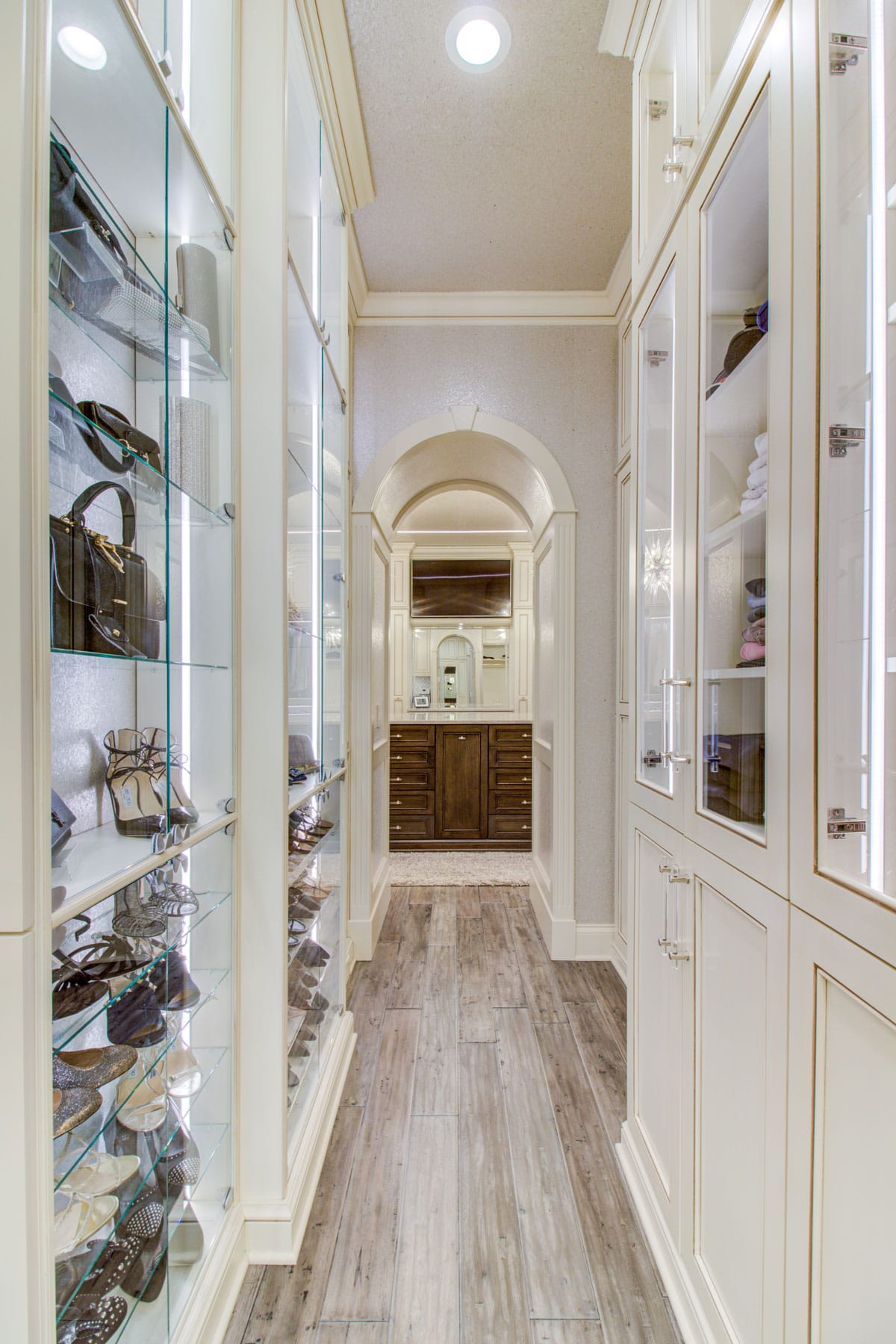 Master suite reatil showcase display for handbags hall way purse closet