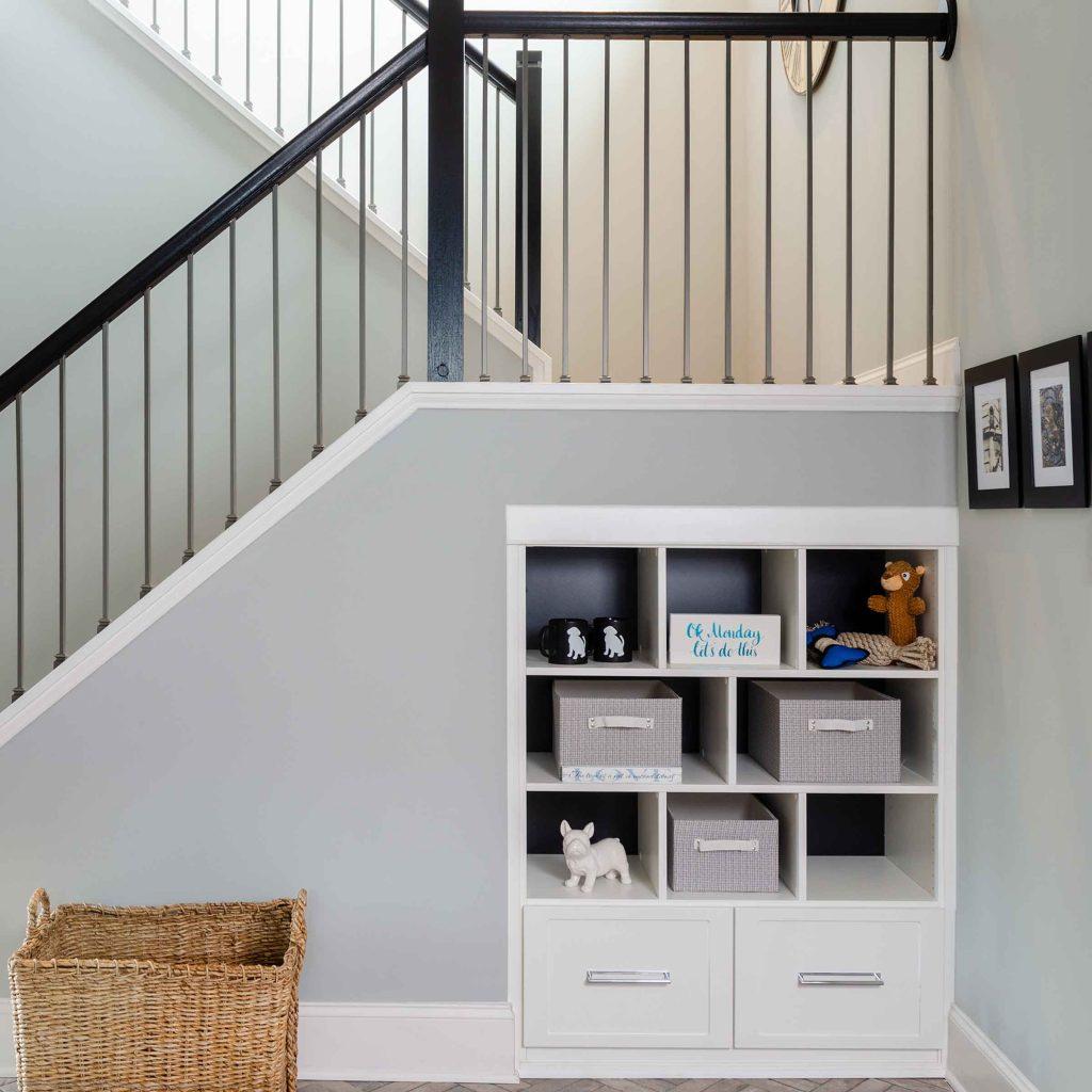 built-in shelves under staircase
