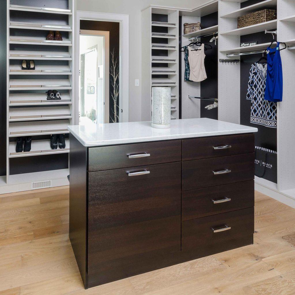 white and dark wood two tone closet