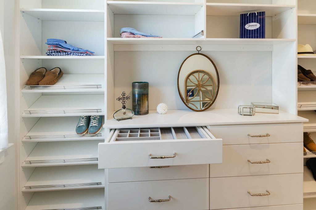 staged closet with open drawer