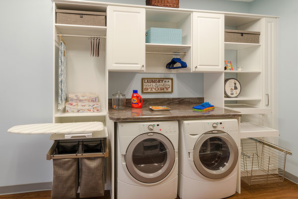Antique White Laundry E Features Cabinetry System For Full Size Washer And Dryer Along With Hamper Cabinet