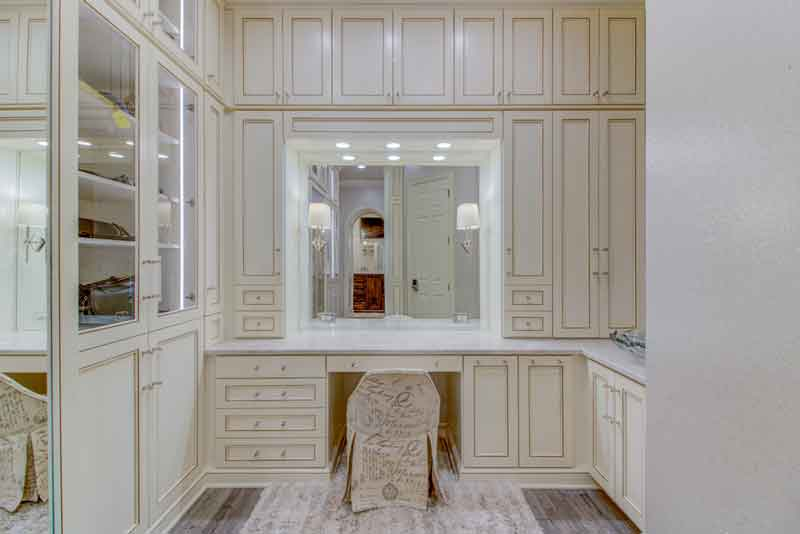 A custom dressing rooms vanity with large mirror.