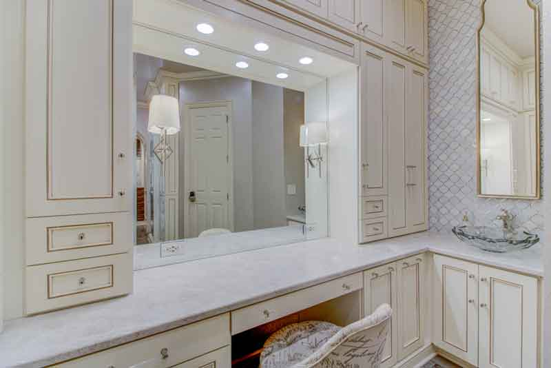 A custom dressing rooms vanity with decorative lighting.