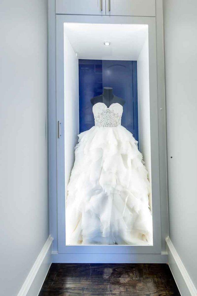 Custom closet system that showcases wedding dress