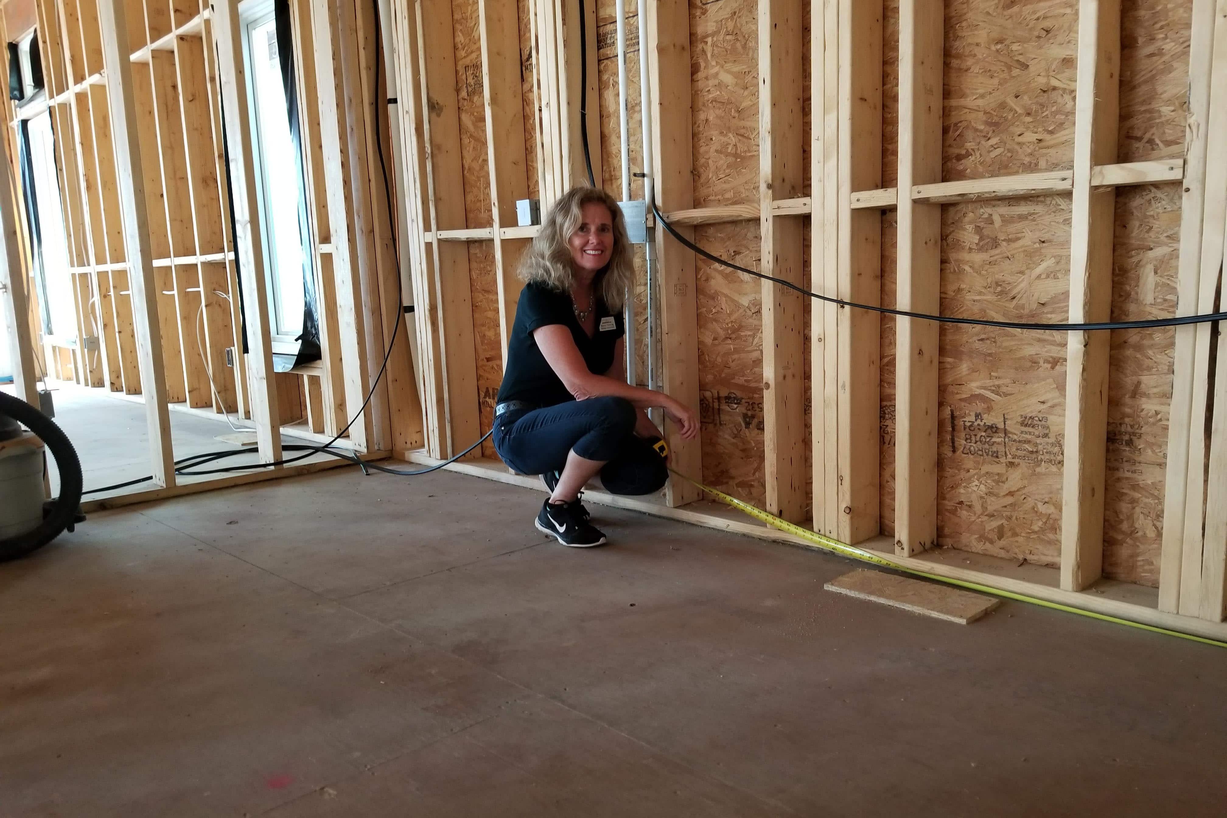 Closet Factory designer measuring a new construction site