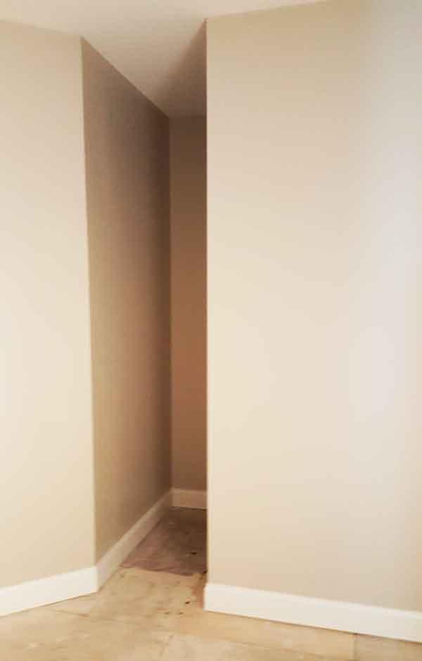 Recessed corner in custom walk-in closet
