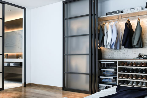 Reach in closet with black sliding doors