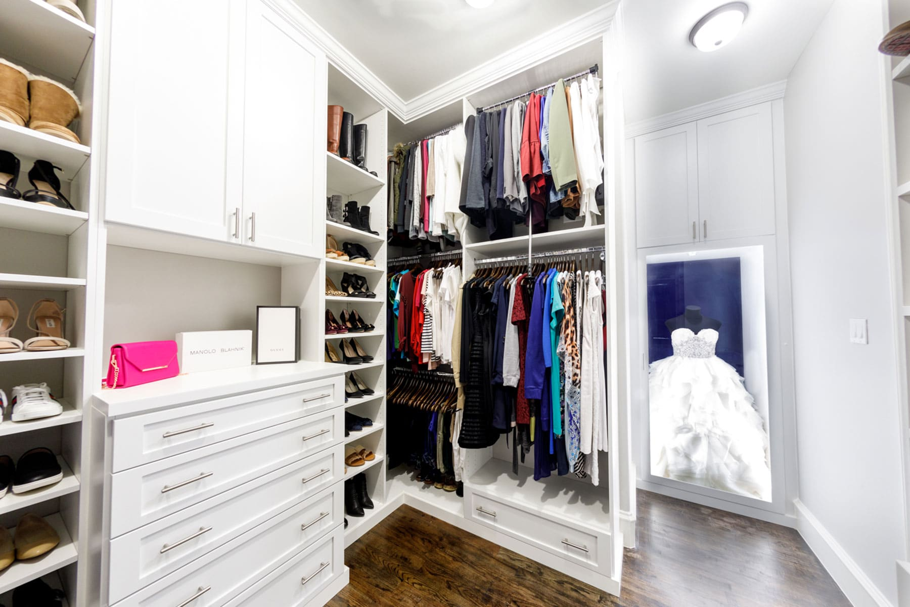 White Walk In Closet With Shaker Style Doors And Wedding Gown Display