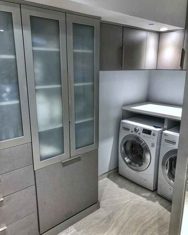 Laundry room in custom dressing room