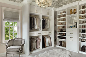 Saint Louis walk-in closet has fluted columns and rosettes.