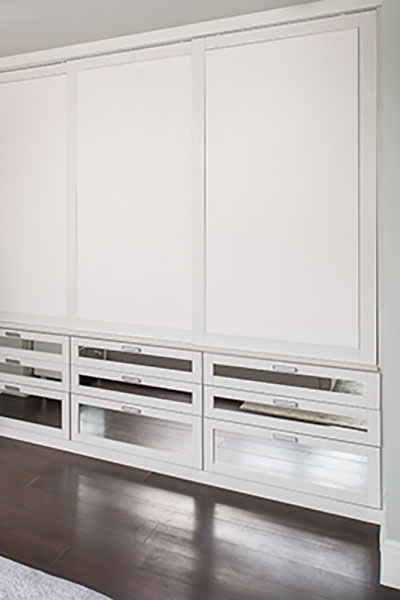 wardrobe closet with kleather doors and mirro drawer fronts