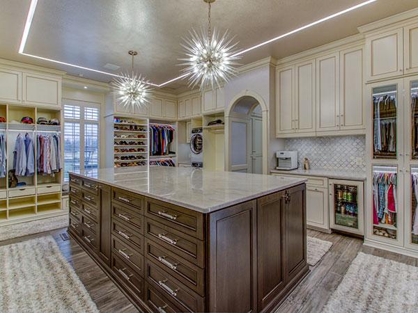 luxury walk-in closet with wood island