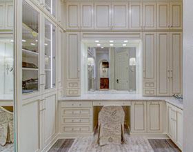 vanity area off walk-in closet suite