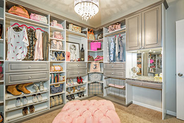 grey walk-in closet is well curated