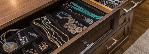 wardrobe closet interior has a jewelry drawer