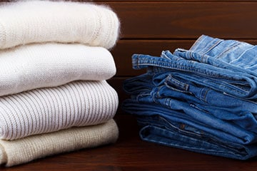 folded sweaters and folded jeans