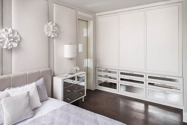 wardrobe closet with leather doors and mirror drawers