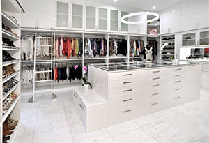 Miami beach glamorous walk-in closet in gloss white.