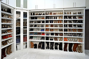 Designer Martha De la Uz shoe closet in high gloss white