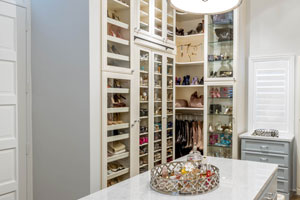 walk-in closet with organized shoes