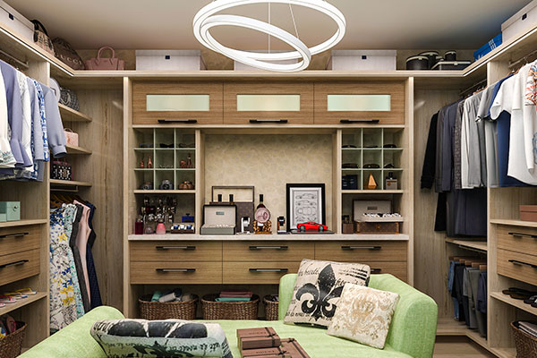large walk-in closet system in woodgrain with sitting area