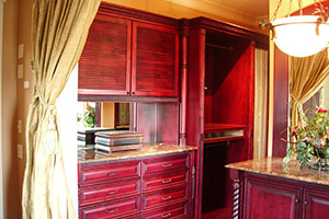 cherrywood closet with slatted doors