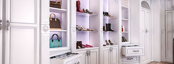 dressing room wall of shoes and drawers