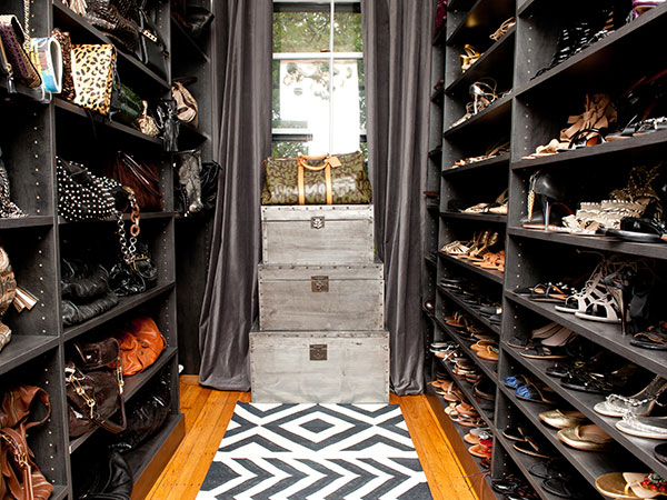 shoe shelves on right wall and handbags left in shoe closet