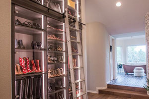 niche converted into shoe storage with ladder
