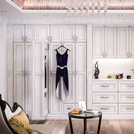 cabinets and drawers in white painted dressing room
