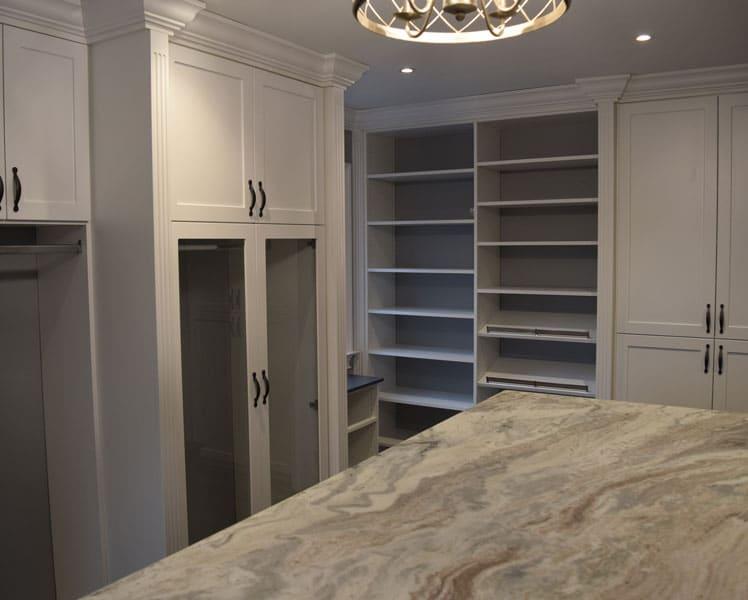 white custom closet with an island