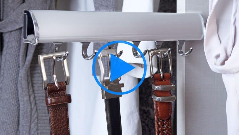 Belts store on a belt rack in a custom closet