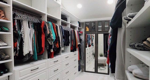 white custom closet with mirrored cabinet doors